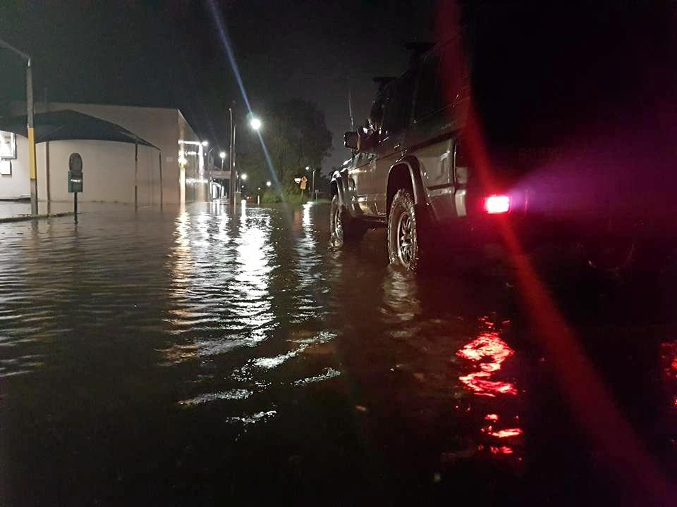The streets outside Nick's IGA Mackay during Tuesday night's heavy downpours.
