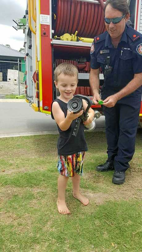 SUPER BOHDY: The three-year-old's mum said her little boy had the time of his life when two firemen let him up into their truck.