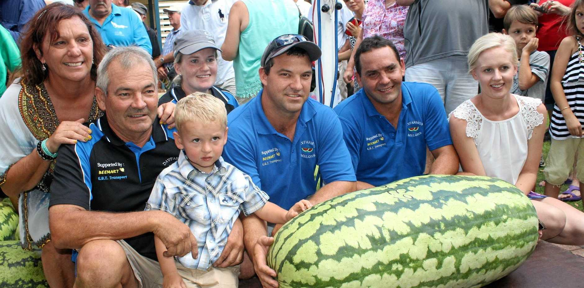 STRAIGHT TO THE POOLROOM: The Davies family were the winners of the 2015 Melon Festival Weigh-In with this monster which came in at 63.5kg. Pictured: Sandy, Bernie, Steph, Fletcher (in front), Chris, Matt and Nikiha Davies.