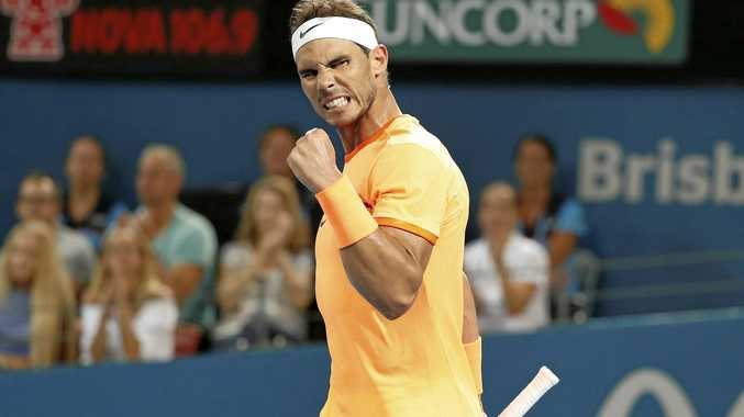 Rafael Nadal of Spain reacts after winning his match against Alexandr Dolgopolov of Ukraine at the Brisbane International.