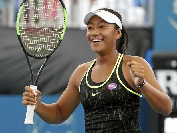 Australia's Destanee Aiava celebrates after winning her first-round match against Bethanie Mattek-Sands of the USA at the Brisbane International.