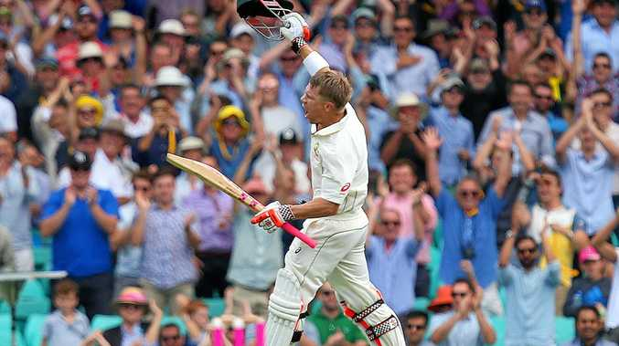 David Warner of Australia jumps in the air after scoring his century against Pakistan at the SCG.
