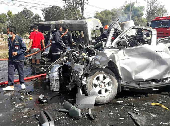 Thai rescue workers at the scene of Monday's fatal collision on a highway in Chonburi province, Thailand. Twenty-five people were killed