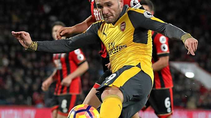 Arsenal's Lucas Perez shoots to score his side's second goal against Bournemouth.