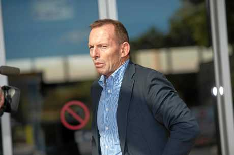 Tony Abbott's team removed a television from his hotel room after growing suspicious.