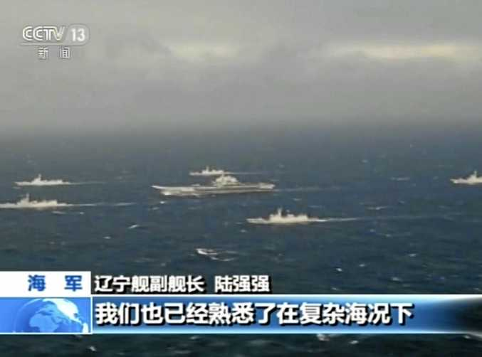 In this image taken from video run by China's CCTV, the aircraft carrier Liaoning is escorted by navy ships during a drill in the South China Sea.