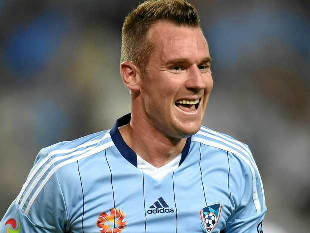 Shane Smeltz celebrates a goal while playing for Sydney FC.