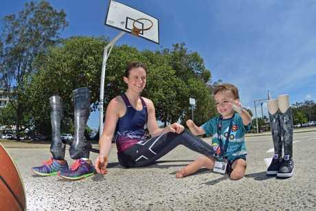 Finn Smith meets wheelchair basketball legend Bridie Kean. Bridie has similiar prosthetic legs similar to Finn. Photo Patrick Woods / Sunshine Coast Daily