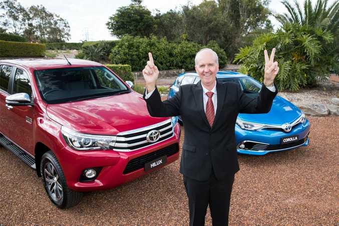 Toyota Australia's Tony Cramb with a HiLux SR5 and Corolla Hybrid