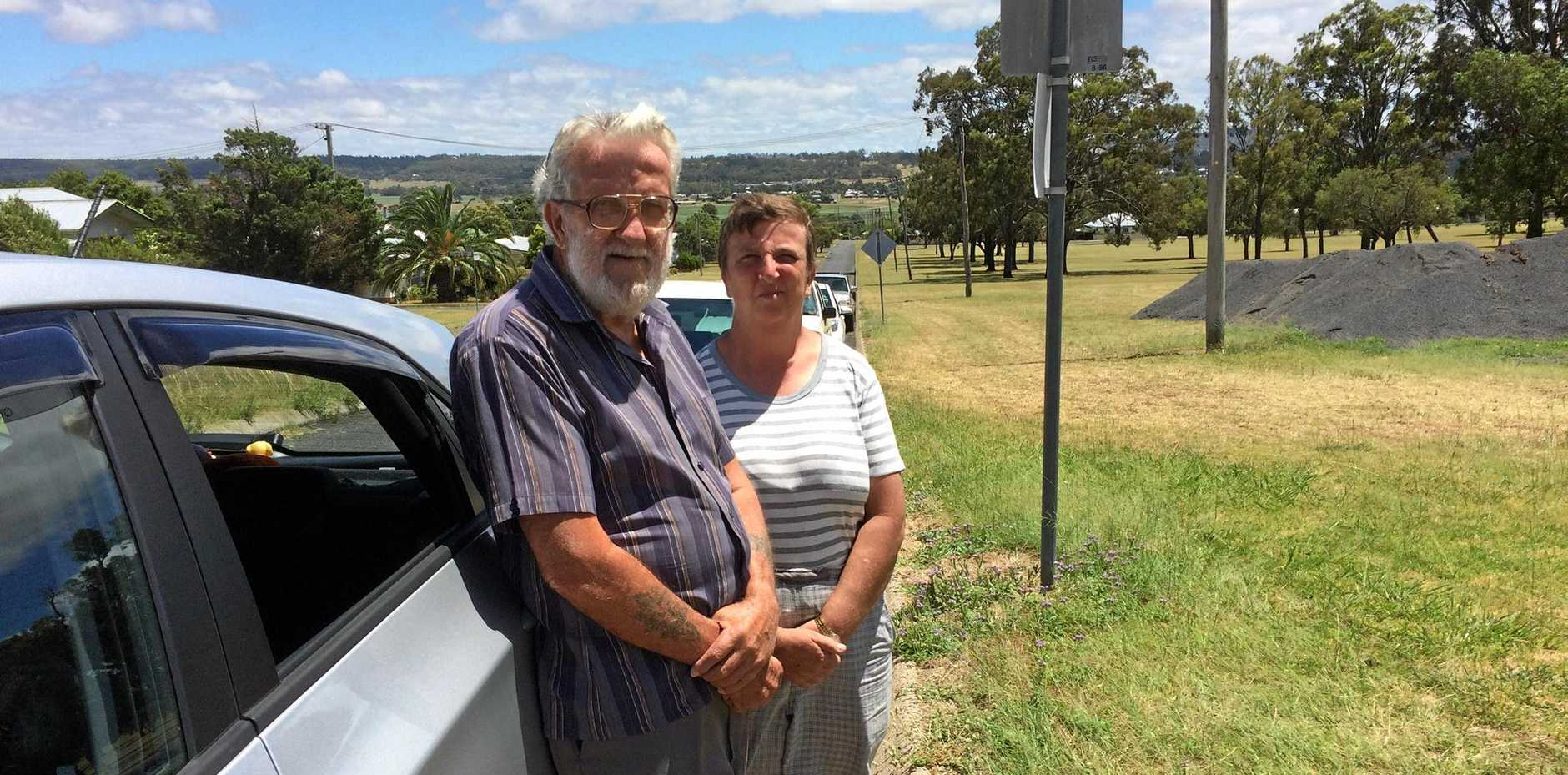Ken and Elizabeth Whiteland with their new car with smashed rear window on Williams St, Warwick where the incident occurred.
