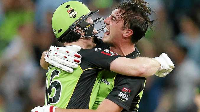 Eoin Morgan (left) of the Sydney Thunder celebrates with teammate Pat Cummins after winning their Big Bash League match against the Melbourne Stars with the last ball at Spotless Stadium.