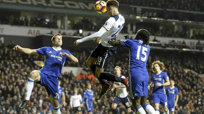Tottenham's Dele Alli scores against Chelsea at White Hart Lane.