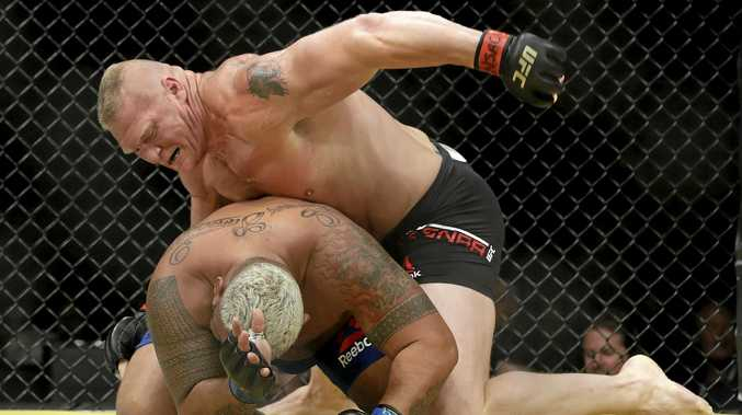 Brock Lesnar (top) fights Mark Hunt in UFC 200 in Las Vegas last July.