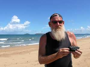 Govt investigates kilos of coal found at Mackay beach