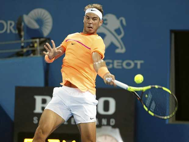 Rafael Nadal of Spain returns during his match against Alexandr Dolgopolov of Ukraine at the Brisbane International.