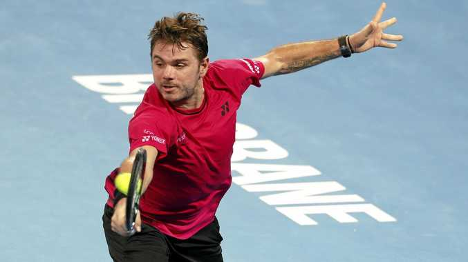 Stan Wawrinka of Switzerland returns during his second-round match against Viktor Troicki of Serbia at the Brisbane International.