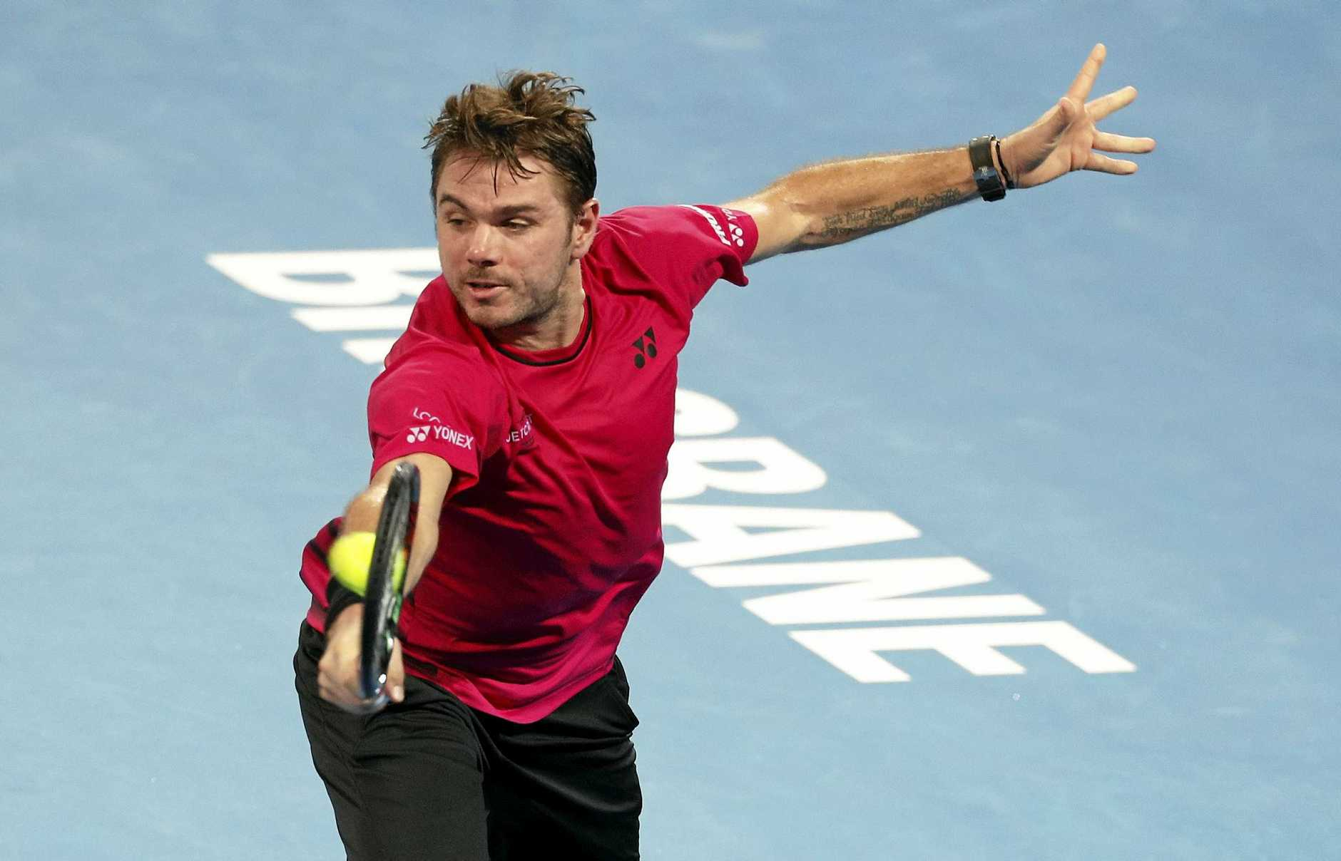Stan Wawrinka of Switzerland returns during his second-round match against Viktor Troicki of Serbia at the Brisbane International.