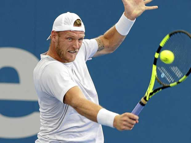 Australia's Sam Groth plays a shot during his match against Dominic Thiem of Austria at the Brisbane International.