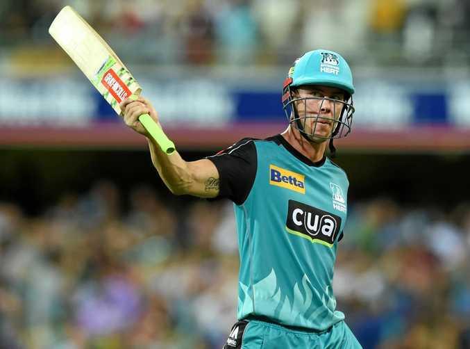 Chris Lynn of the Brisbane Heat raises his bat after helping defeat the Hobart Hurricanes.