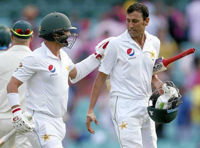 Pakistan's Younis Khan (right) gets a pat on the back from teammate Yasir Shah after Khan was 136 not out at the end of the day's play.