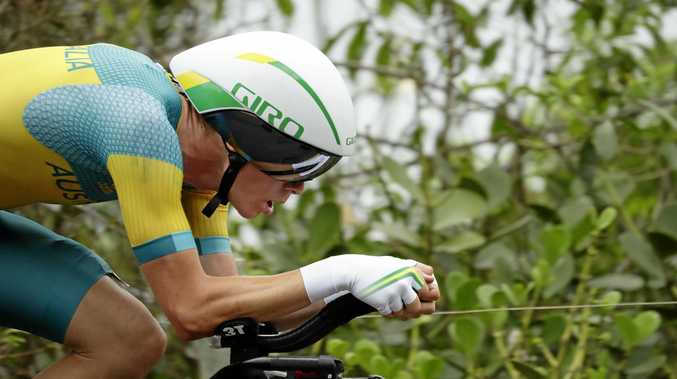 Rohan Dennis has overcome illness to defend his national time trial title.