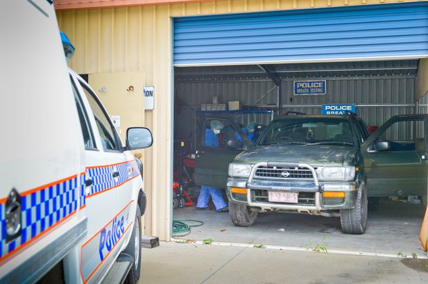 INVESTIGATION: Police are combing over a Nissan Pathfinder for evidence.