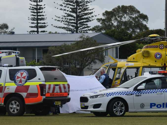 Emergency services treating a patient who was involved in a motorbike crash.
