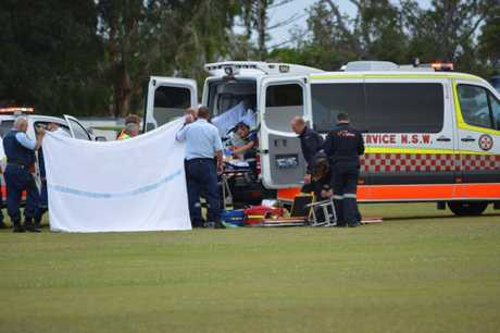 Emergency services working on a man who was hurt in a motorbike crash at Ballina.