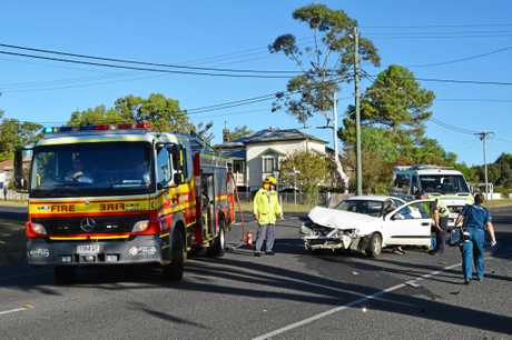 Emergency services attend the scene of a crash at the intersection of Percy and Wallace St, Warwick.