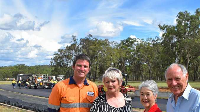 Overseeing the laying of the new track at Morgan Park are Downer General Manager Airports and Specialised Pavements Mark Taylor, Cr Yve Stocks, Mayor Tracy Dobie and President of Warwick District Sporting Car Club John Torr.