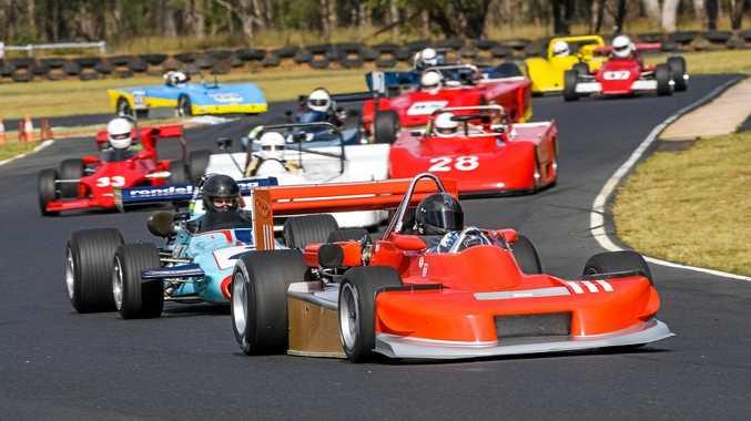RACING: Peter Warren leads Dean Tighe in a race at Morgan Park Raceway.