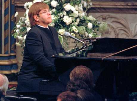 Pop singer Elton John  plays a specially re-written version of his classic Candle in the Wind during the funeral service for Diana, Princess of Wales at London's Westminster Abbey, Saturday Sept. 6 1997. Millions of people lined the streets of London to watch the funeral procession of the Princess who died in a car crash in Paris on Aug. 31.  (AP Photo/Paul Hackett/POOL)