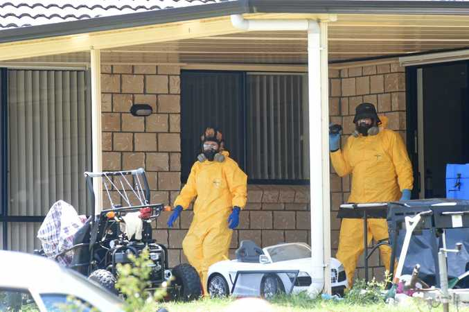 DRUG BUST: The chemical operations unit from Sydney examined the garage of a house in Tenterfield on New Year's Eve which is alleged to be a a clandestine laboratory, along with other items and drug paraphernalia.