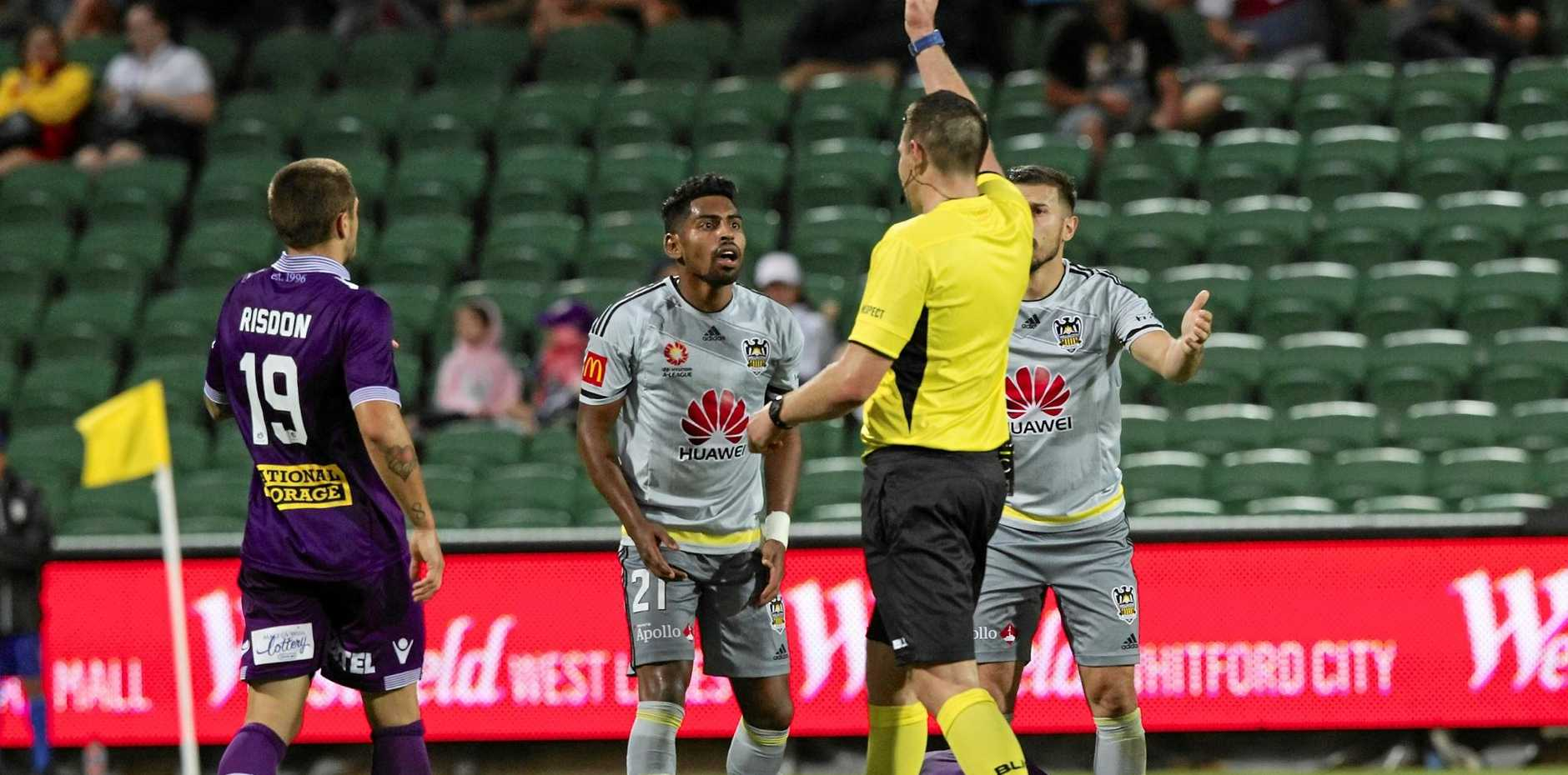 Roy Krishna of the Phoenix is shown the red card for a foul on Shane Lowry of the Glory.