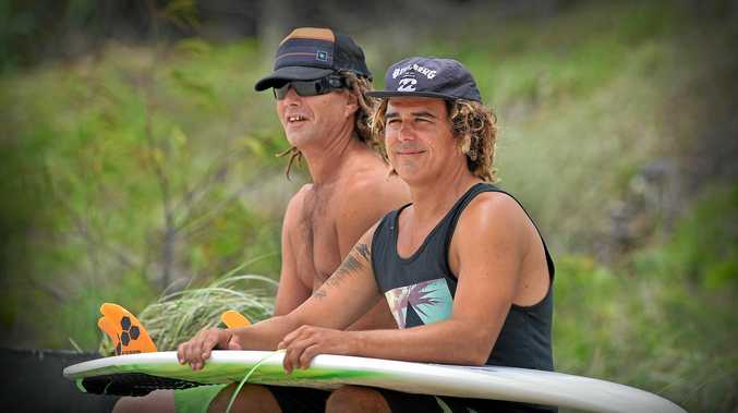 ENDLESS SEARCH: Looking in vain for surf at Maroochydore are Dave Copland and Greg Storey, of Phillip Island.