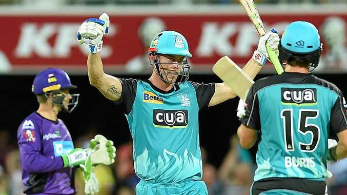 Chris Lynn (centre) of the Brisbane Heat.