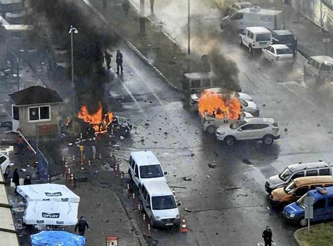 Cars burn after an explosion outside a courthouse in the coastal city of Izmir, Turkey
