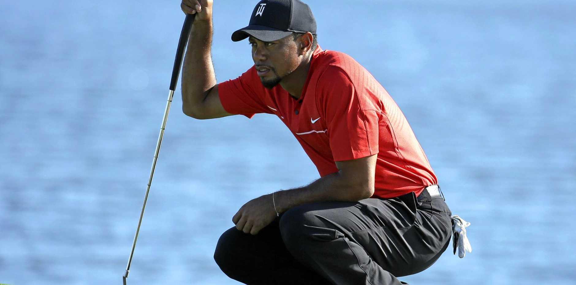 Tiger Woods lines up a putt.