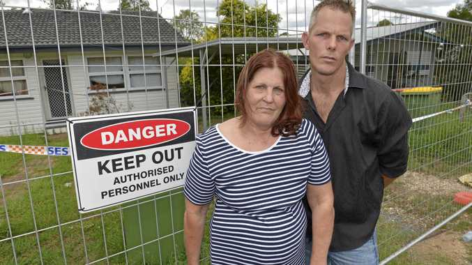 TOUGH TIMES: Paula Harris and her son Cyril are living in emergency accommodation and had to leave all their worldly possessions inside their North Booval home.