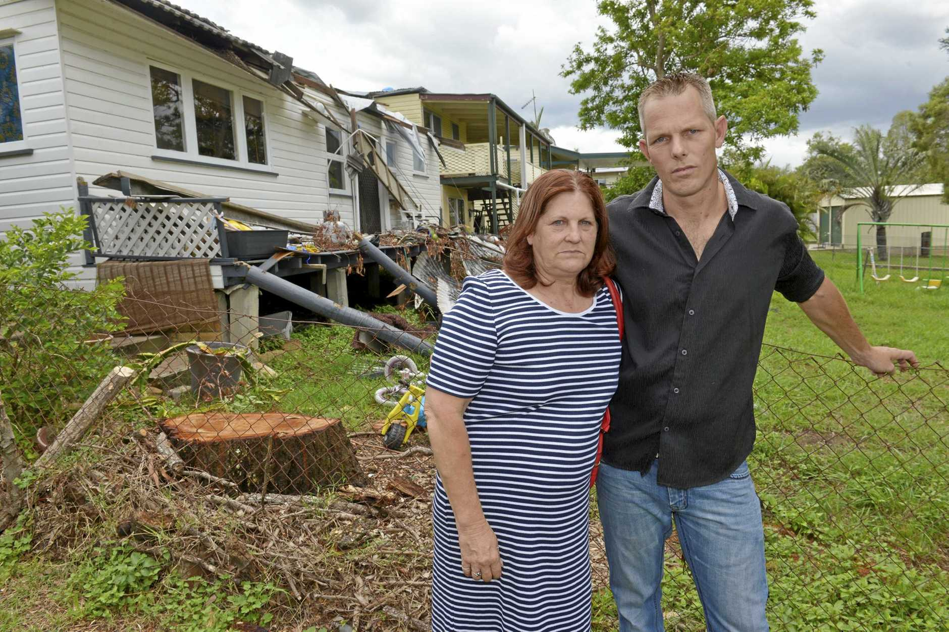 TOUGH TIMES: Paula Harris and her son Cyril are living in emergency accommodation and had to leave all their worldly possessions inside their North Booval rental home after it was destroyed during the December storm.