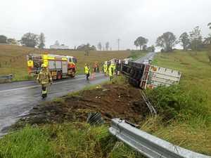 Truck rolls over in wet weather, spills oil