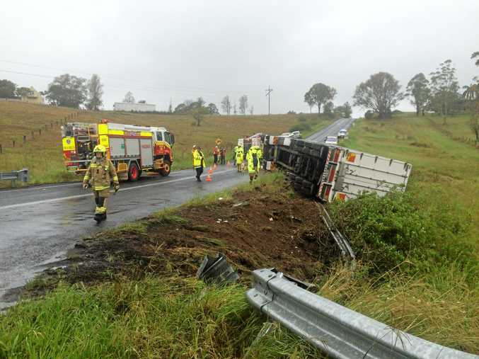 A truck has crashed and rolled at the intersection of Centenary Drive and the Pacific Highway at Clarenza.