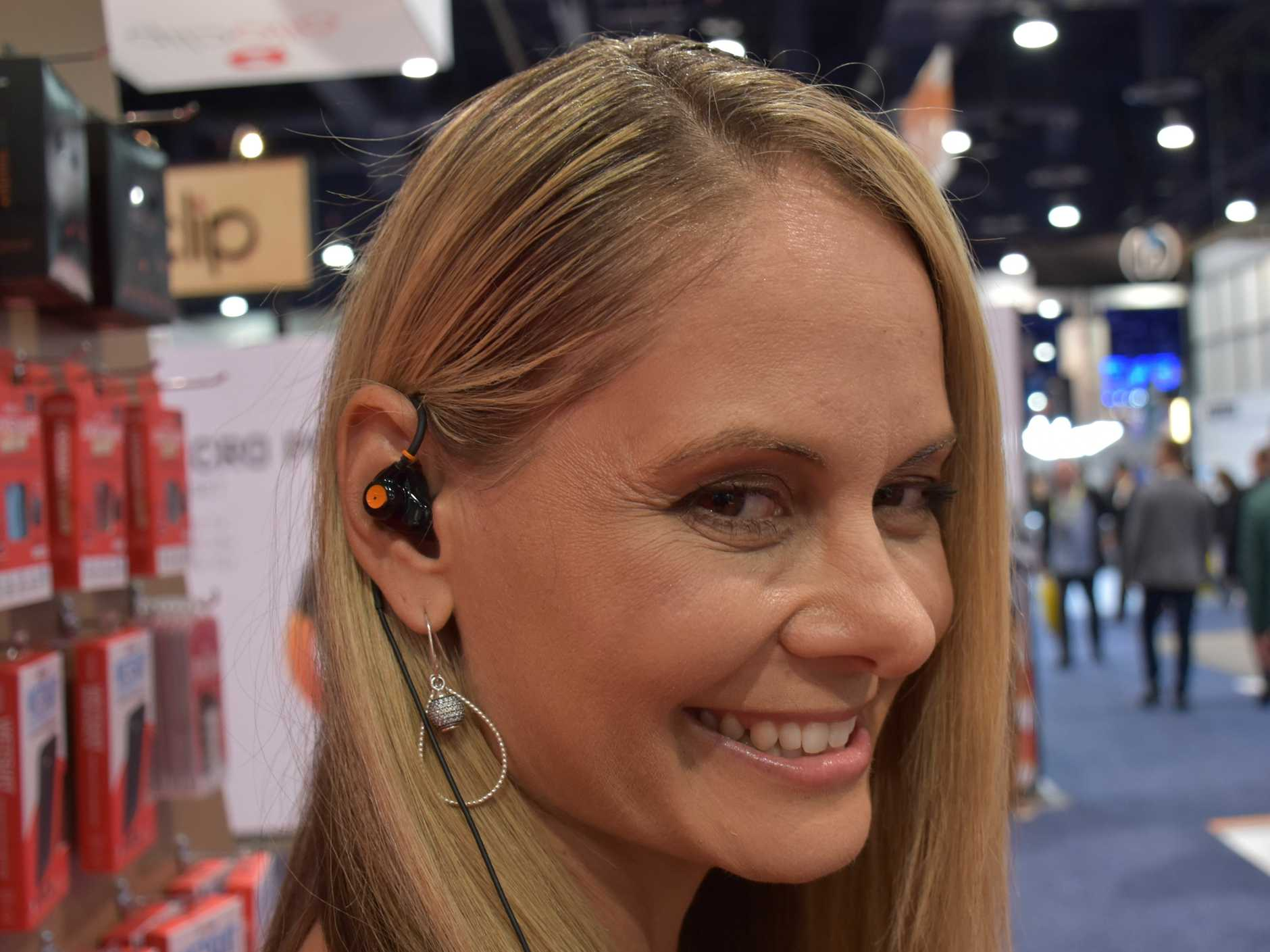 Maria Ranchod, of Dog and Bone, models Earmade at CES 2017 in Las Vegas plus insert of product.