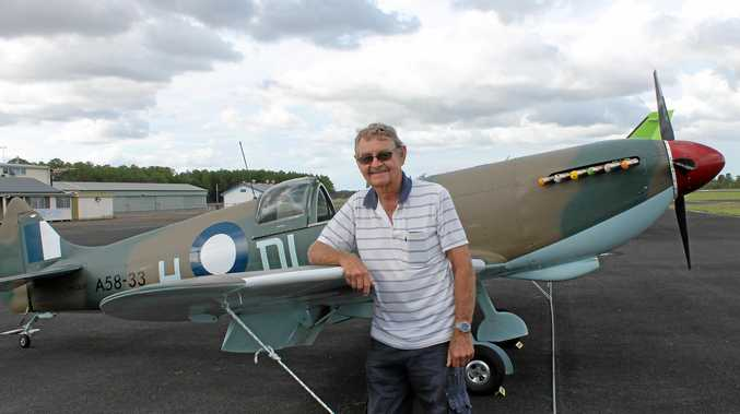 SELF-BUILT REPLICA: Gootchie farmer John Kelman with his completed Spitfire replica plane at Maryborough Airport. He started building it in 2003.