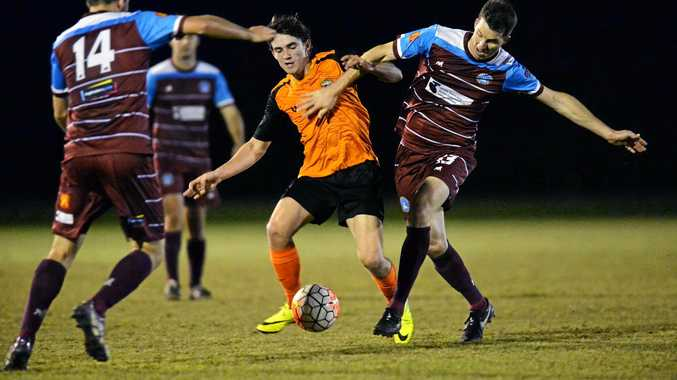 SOCCER: Jed Zanos gets swamped by defence when playing for Buderim in 2016.