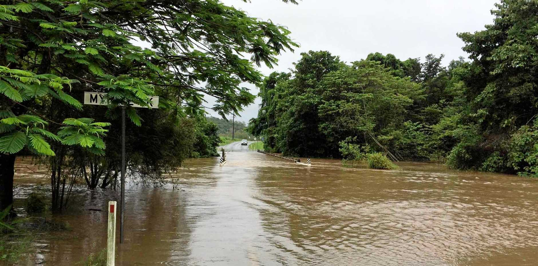 A road train was swept from the highway at Amby, where the Amby Creek had flooded.