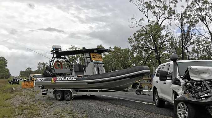 CRASH: A police vehicle towing a police patrol boat hit after it stopped to assist with a road hazard.