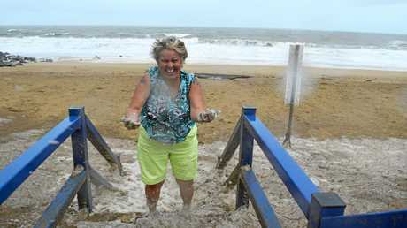 Vicky Kisina had a ball playing in the 'suds' washed up at Lamberts Beach this morning.