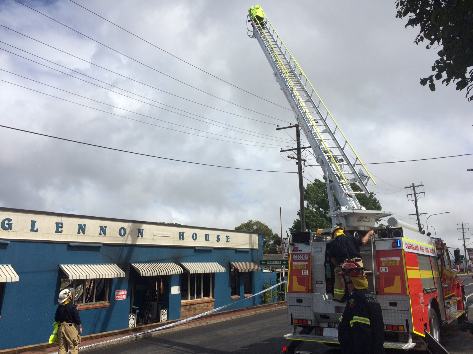 Firefighters clear the scene at the Glennon House Motel fire that gutted the building.