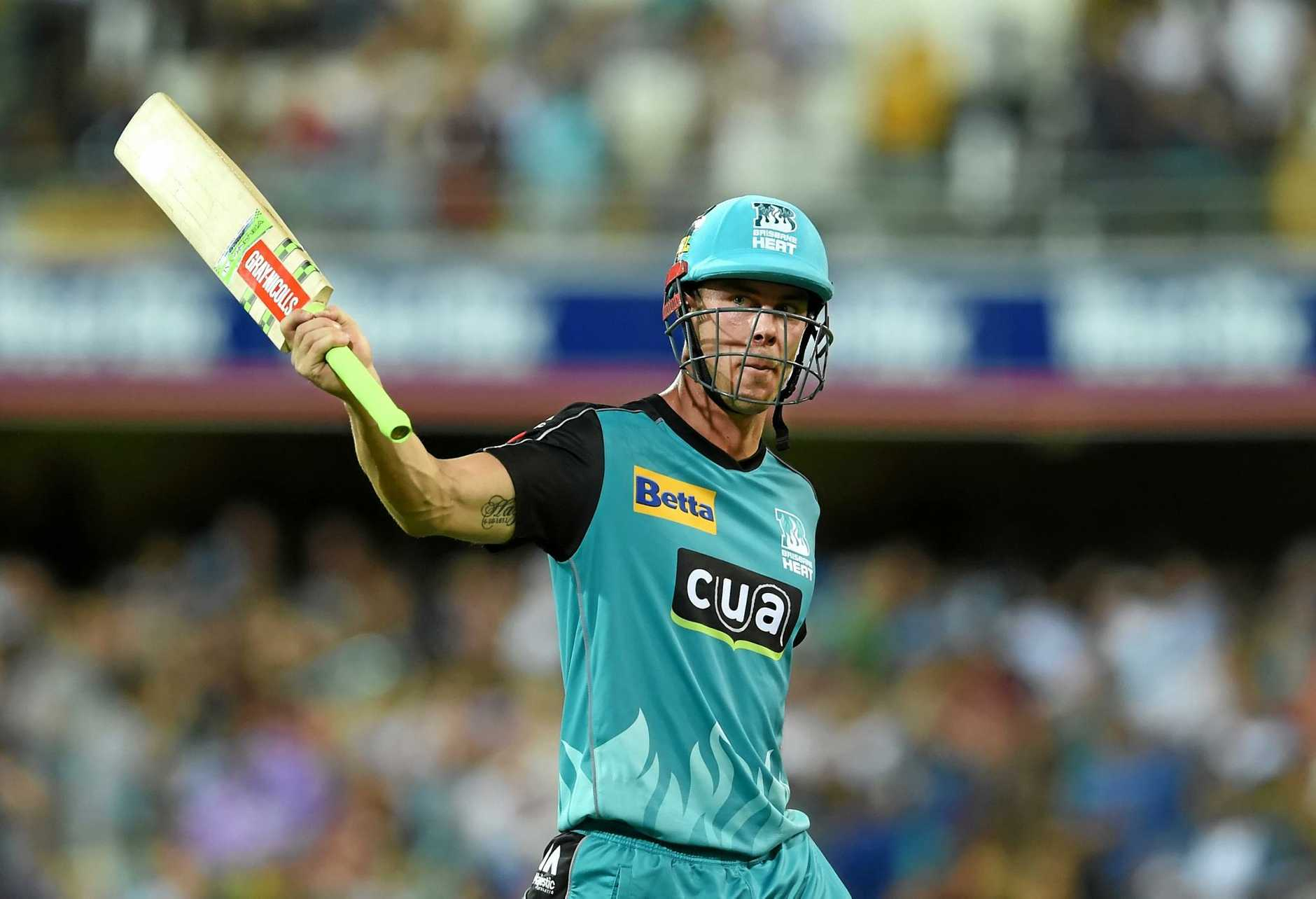 Chris Lynn of the Brisbane Heat raises his bat after his side's win over the Hobart Hurricanes.
